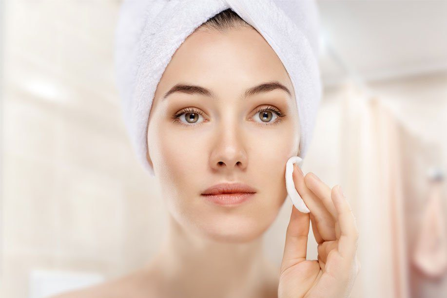 Woman Cleansing Face